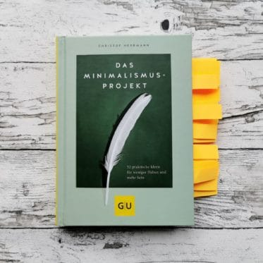 Auf dem Bild ist das Buchcover des Buchs Das Minimalismus-Projekt zu sehen.